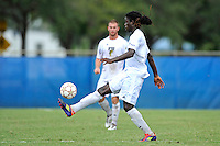 2 October 2011:  FIU defender Jahbari Willis (7) passes the ball in the second half as the FIU Golden Panthers defeated the University of Kentucky Wildcats, 1-0 in overtime, at University Park Stadium in Miami, Florida.