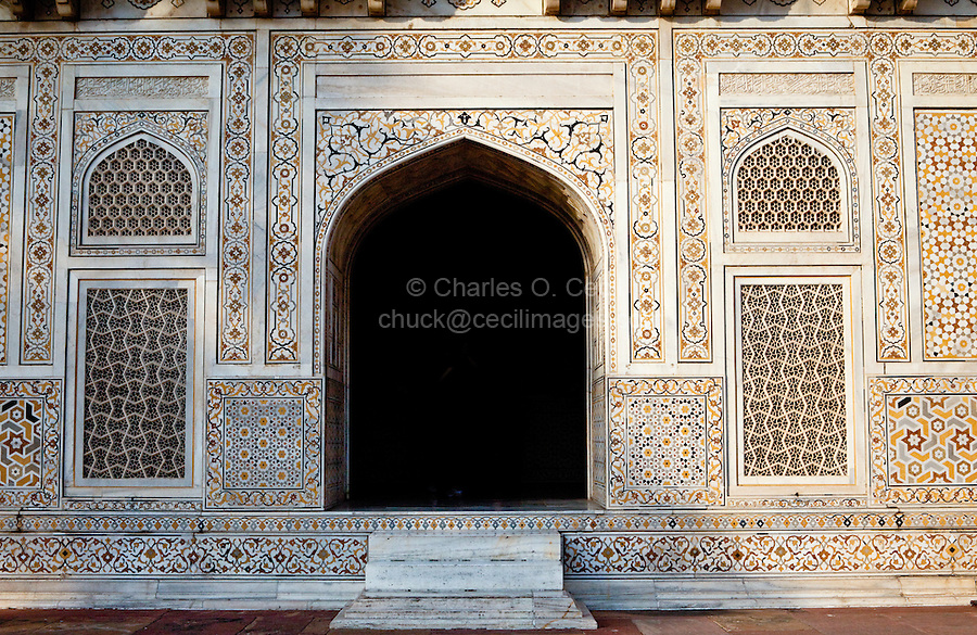 """Agra, India.    Entrance to the Itimad-ud-Dawlah, Mausoleum of Mirza Ghiyas Beg.  The tomb is sometimes referred to as the """"Baby Taj.""""  It is one of the finest examples of pietra dura work, making designs through the use of inlaid colored stone."""