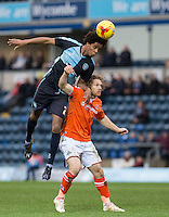 Sido Jombati of Wycombe Wanderers beats Craig Mackail-Smith of Luton Town in the air during the Sky Bet League 2 match between Wycombe Wanderers and Luton Town at Adams Park, High Wycombe, England on 6 February 2016. Photo by Andy Rowland.