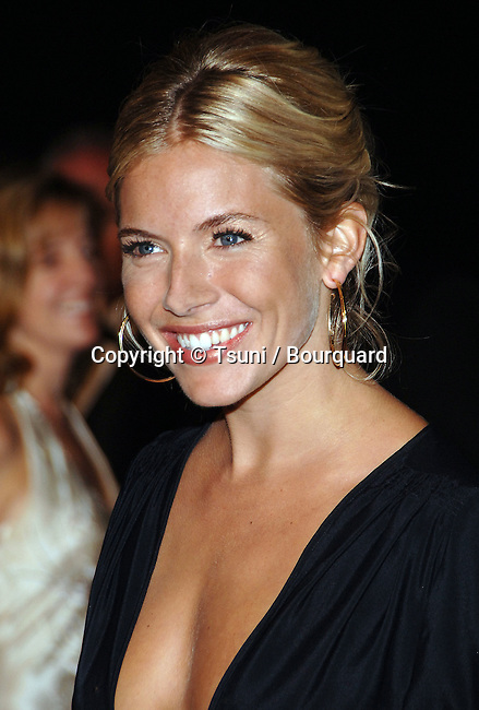 Sienna Miller arriving at the PALM  SPRING International Film Festival at the Convention Center. January 6, 2007<br /> <br /> headshot<br /> smile