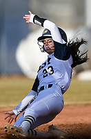 NWA Democrat-Gazette/CHARLIE KAIJO Bentonville West High School infielder Kylee Tomlinson (23) slides to second during a softball game, Thursday, March 13, 2019 at Bentonville West High School in Centerton.