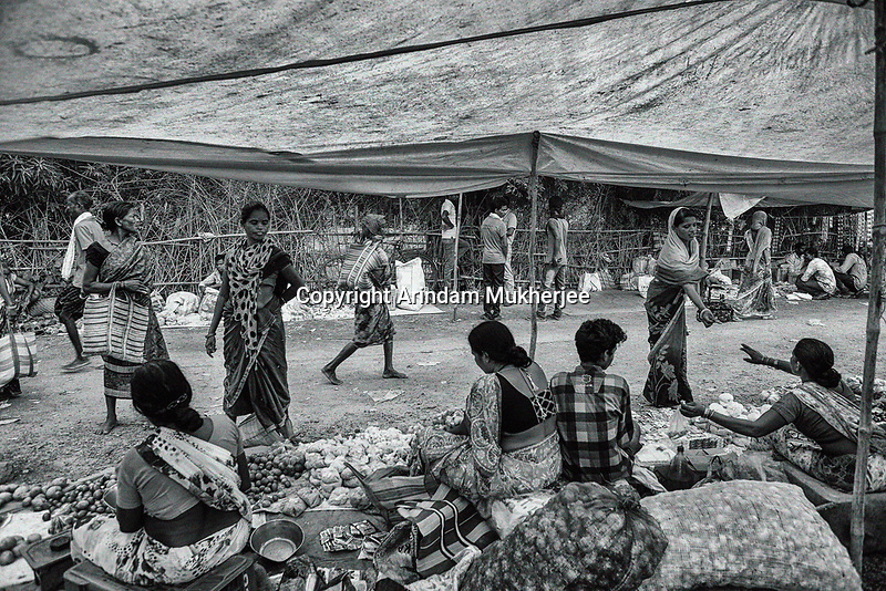 Weekly tribal market at Sukma. Groceries to mobile phone everything is available in these weekly markets.  Chattisgarh, India. Arindam Mukherjee.