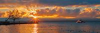 Boat on Lake Léman at sunrise