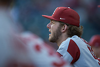 Evan Gray (58) of the Arkansas Razorbacks watches from the dugout during the game against the Oklahoma Sooners in game two of the 2020 Shriners Hospitals for Children College Classic at Minute Maid Park on February 28, 2020 in Houston, Texas. The Sooners defeated the Razorbacks 6-3. (Brian Westerholt/Four Seam Images)