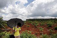 A woman stands near to banana plantations on the Leizhou peninsula, Guangdong Province. 2010