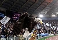Calcio, Serie A: Lazio vs Roma. Roma, stadio Olimpico, 11 novembre 2012..Olimpia the eagle, Lazio's mascot, is seen past Lazio fans at the end of the Italian Serie A football match between Lazio and AS Roma, at Rome's Olympic stadium, 11 November 2012. Lazio won 3-2..UPDATE IMAGES PRESS/Riccardo De Luca