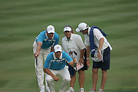 Henrick Stenson & Robert Karlson with their caddies assess the line of a putt on 16during Satuday's afternoon fourball at the 37th Ryder Cup at Valhalla Golf Club, Louisville, Kentucky, USA - 20th September 2008 (Photo by John Hetherton/GOLFFILE)