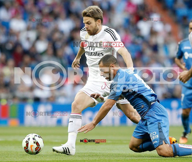 Real Madrid's Asier Illarramendi (l) and Getafe's Medhi Lacen during La Liga match. May 23,2015. (ALTERPHOTOS/Acero) /NortePhoto.com