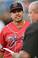 Manager Iggy Suarez (2) of the Greenville Drive, playing as the Energia in MiLB's Copa de la Diversion, meets with umpires before a game against the Augusta GreenJackets on Wednesday, April 10, 2019, at Fluor Field at the West End in Greenville, South Carolina. Augusta won, 9-8. (Tom Priddy/Four Seam Images)