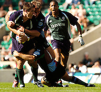 20040904 London Irish v Harlequins. Zurich Premiership..Exiles wing Scott Staniforth, find his run halted..Photo  Peter Spurrier.email images@intersport-images Mob +447973819551.