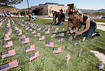 Western Nevada College Veterans Resource Center volunteers plant nearly 8,000 American flags at the campus, in Carson City, Nev., on Friday, May 1, 2015. The group will hold a Veterans Suicide Walk Saturday, May 2 at starting 10 a.m. at Bully's Sports Bar and Grill to help raise awareness of the 8,030 veteran suicides each year. <br /> Photo by Cathleen Allison/Nevada Photo Source