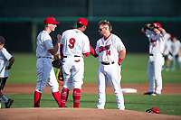 Orem Owlz first baseman Connor Fitzsimons (14) wishes good luck to Kevin Maitan (9) and John Swanda (5) before a Pioneer League game against the Ogden Raptors at Home of the OWLZ on August 24, 2018 in Orem, Utah. The Ogden Raptors defeated the Orem Owlz by a score of 13-5. (Zachary Lucy/Four Seam Images)