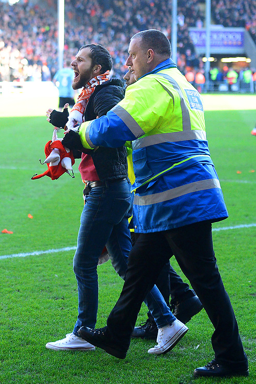 a Blackpool fan is removed from the pitch <br /> <br /> Photographer Richard Martin-Roberts/CameraSport<br /> <br /> The EFL Sky Bet League One - Blackpool v Southend United - Saturday 9th March 2019 - Bloomfield Road - Blackpool<br /> <br /> World Copyright © 2019 CameraSport. All rights reserved. 43 Linden Ave. Countesthorpe. Leicester. England. LE8 5PG - Tel: +44 (0) 116 277 4147 - admin@camerasport.com - www.camerasport.com