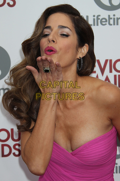 Ana Ortiz<br /> Lifetime Original Series &quot;Devious Maids&quot; Premiere Party Held At Bel- Air Bay Club, Pacific Palisades, California, USA.<br /> June 17th, 2013<br /> half length pink dress and ring blowing kiss cleavage<br /> CAP/ADM/RE<br /> &copy;Russ Elliot/AdMedia/Capital Pictures