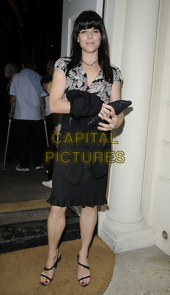 NEVE CAMPBELL.Arrives for the Annual Omar Sharif Backgammon Tournament, Sketch bar & restaurant, London, England, UK, .May 16th 2010..full length fringe black skirt strappy sandals top clutch bag pink grey gray frill edge hem ruffle flower floral patterned pattern .CAP/CAN.©Can Nguyen/Capital Pictures.