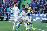 Getafe CF's Damian Suarez (c) and Real Madrid's Isco Alarcon (l) and Dani Carvajal during La Liga match. January 4,2020. (ALTERPHOTOS/Acero)