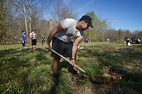 NWA Democrat-Gazette/BEN GOFF @NWABENGOFF<br /> Michael Dickerson, Camp War Eagle counselor, from Stillwater, Okla. plants a tree Saturday, March 18, 2017, as a group from Camp War Eagle's Primetime Retreat for grades 6-8 take part in the Illinois River Watershed Partnership's 10th annual Riparian Project along the Razorback Regional Greenway near Mercy Trailhead in Rogers. About 500 saplings of native species, including oaks, sycamore and river birch, were planted by campers and staff at the location.