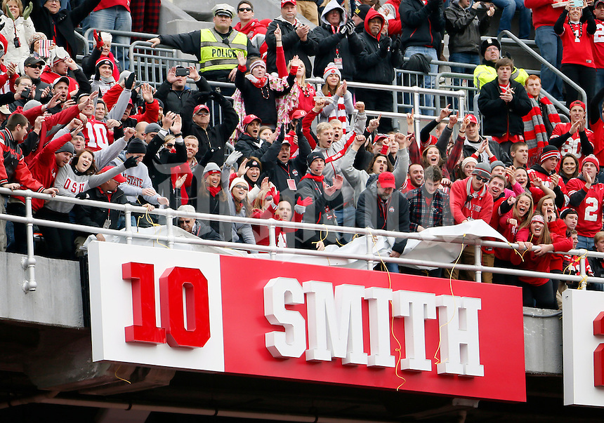 Ohio State Buckeyes fans cheer as former Buckeye Troy Smith was introduced in the ring of honor against Michigan Wolverines at Ohio Stadium in Columbus, Ohio on November 29, 2014.  (Dispatch photo by Kyle Robertson)
