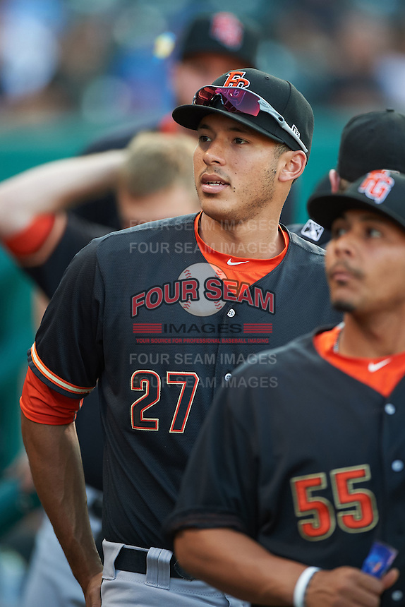 Fresno Grizzles Carlos Correa (27) in the dugout during a game against the Oklahoma City Dodgers on June 1, 2015 at Chickasaw Bricktown Ballpark in Oklahoma City, Oklahoma.  Fresno defeated Oklahoma City 14-1.  (Mike Janes/Four Seam Images)