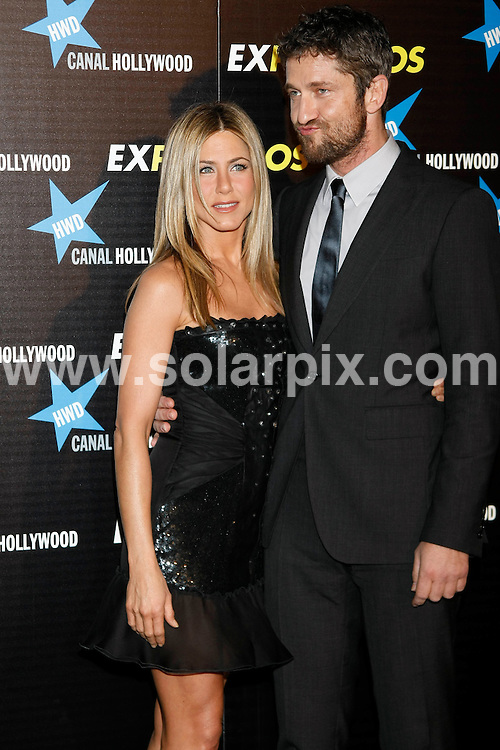 **ALL ROUND PICTURES FROM SOLARPIX.COM**.**UK SYNDICATION RIGHTS ONLY**.Arrivals for the gala screening of the new film The Bounty Hunter aka Exposados in Spanish. Madrid, Spain. 30 March 2010...This pic: Jennifer Aniston and Gerard Butler..JOB REF: 11015 SKX      DATE:  30_03_2010.**MUST CREDIT SOLARPIX.COM OR DOUBLE FEE WILL BE CHARGED**.**MUST NOTIFY SOLARPIX OF ONLINE USAGE**.**CALL US ON: +34 952 811 768 or LOW RATE FROM UK 0844 617 7637**