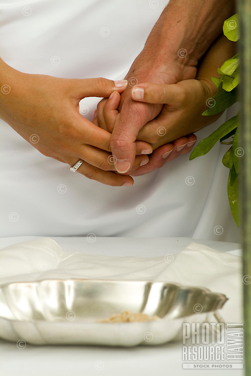 A bride and groom holding hands