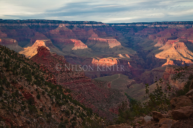 Sun setting on canyon rocks and wals in Grand Canyon in Arizona
