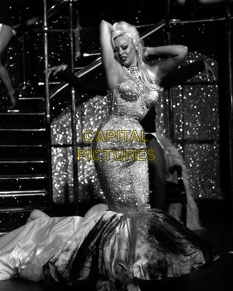Immodesty Blaize (born Kelly Fletcher).Performing at the Windmill Theatre, London, England..July 24th, 2011.stage concert performance burlesque show dress fishtail sparkly arms in air dance dancing full length.CAP/COA/CC.©CC/COA/Capital .