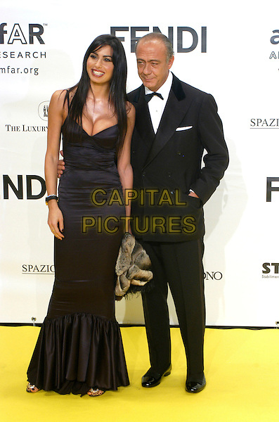 ELISABETTA GREGORACI & FAWAZ GRUOSI.Inauguration for the amfARr's Cinema Against AIDS during the 2nd Annual Rome Film Festival, Rome, Italy, .26 October 2007..full length black dress.CAP/CAV.©Luca Cavallari/Capital Pictures.