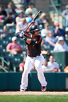 Rochester Red Wings second baseman Jose Martinez (4) at bat during a game against the Norfolk Tides on May 3, 2015 at Frontier Field in Rochester, New York.  Rochester defeated Norfolk 7-3.  (Mike Janes/Four Seam Images)