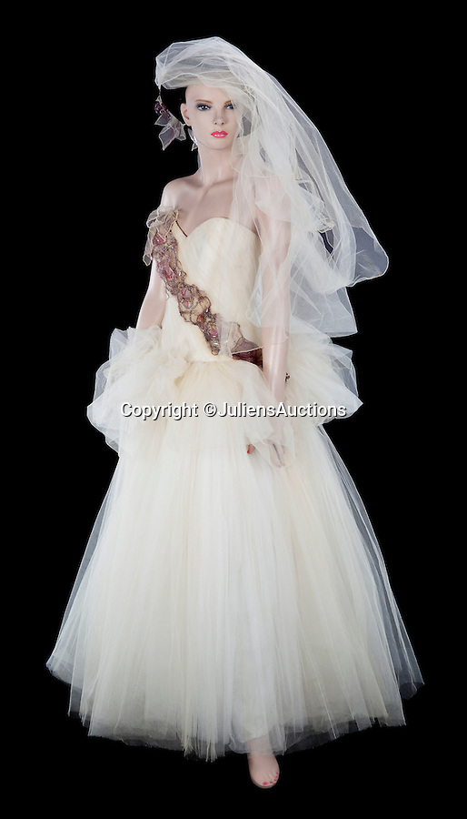 BNPS.co.uk (01202 558833)<br /> Pic: JuliensAuctions/BNPS<br /> <br /> ***Please Use Full Byline***<br /> <br /> Madonna Wedding Gown worn to marriage ceremony of Sean Penn. Est: $40,000 - 60,000.<br /> <br /> A British hedge fund company is about to cash-in on a surprisingly-secure investment - Madonna.<br /> <br /> Marquee Capital was launched in 2005 looking for investors to raise a six-figure kitty to snap up celebrity memorabilia.<br /> <br /> The organisation bought more than 140 Madonna items, mostly costumes and jewellery, she wore during her movie and singing career.<br /> <br /> The goods included dozens of outfits from the 1996 hit musical Evita as well as the star's peach baseball dress and glove from her 1992 movie 'A League of Their Own' and a vest top and jeans she wore for her music video of American Pie.<br /> <br /> The sale takes place at LA-based Julien's Auctions on November 7.