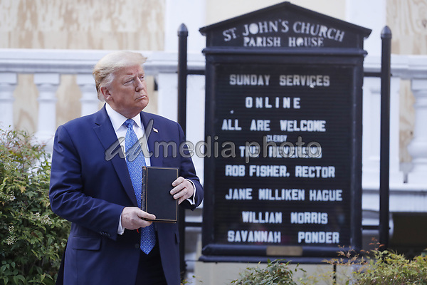 United States President Donald J. Trump poses with a bible outside St. John's Episcopal Church after delivering remarks in the Rose Garden at the White House in Washington, DC, USA, 01 June 2020. Trump addressed the nationwide protests following the death of George Floyd in police custody.<br /> Credit: Shawn Thew / Pool via CNP/AdMedia