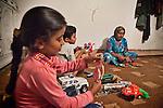 06/06/14. Goktapa, Iraq. Rahima is preparing dinner as the kids play in their home.