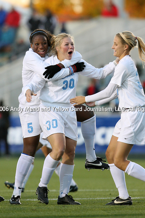North Carolina's Elizabeth Guess (30) celebrates her goal at 1:22 with Jaime Gilbert (5) and Sterling Smith (r) on Friday, November 3rd, 2006 at SAS Stadium in Cary, North Carolina. The University of North Carolina Tarheels defeated the Clemson University Tigers 3-0 in Atlantic Coast Conference Women's Soccer Championship semifinal game.