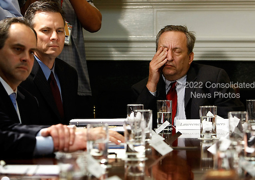Washington, DC - April 23, 2009 -- White House National Economic Council Director Larry Summers (R) nods off while United States President Barack Obama talks to the press after a meeting with officials from the credit card industry at the White House, Thursday, April 23, 2009 in Washington, DC. CEOs from Visa, Mastercard, American Express and the credit card divisions at about a dozen of the largest banks were invited to speak with Obama about high fees and predatory lending practices. The timing is hard for the companies as the House Financial Services Committee approved legislation cracking down on credit card billing practices on Wednesday.  .Credit: Chip Somodevilla - Pool via CNP