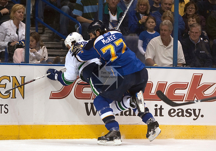 April 19 2009     Blues player Jay McKee (77) pushes Canucks Ryan Johnson (10) into the boards in the first period.   The St. Louis Blues hosted the Vancouver Canucks in the third playoff game between the two teams on Sunday April 19, 2009 at the Scottrade Center in downtown St. Louis, MO.  The Blues entered the game down 2-0 in the best of seven series.  ..            *******EDITORIAL USE ONLY*******