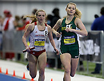 BROOKINGS, SD - FEBRUARY 24:  Kayla Huhnerkoch from North Dakota State University leads Rachael Zeiger from the University of South Dakota with one lap to go in the women's distance medley Friday afternoon at the Summit League Indoor Championships in Brookings, SD. (Photo by Dave Eggen/Inertia)
