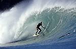19 October 2005, Mundaka, Spain --- Supanish surfer Jaime Fernandez rides a big wave in Mundaka, northern Spain. Photo by Victor Fraile --- Image by © Victor Fraile/Corbis