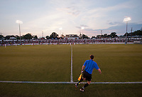 Assistant referee Dean Fairweather runs the sideline during a third round match in the US Open Cup at City Stadium in Richmond, VA.  D.C. United advanced on penalty kicks after tying the Richmond Kickers, 0-0.