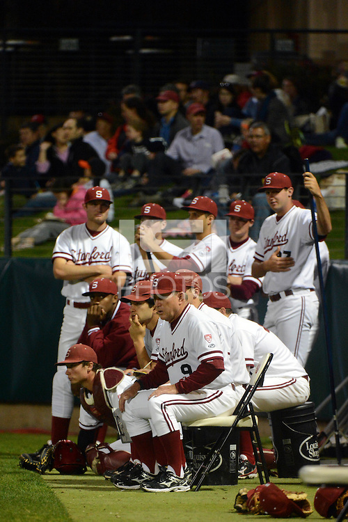 Stanford, CA - Friday, March 1, 2013: Stanford Cardinal head coach Mark Marquess (9) sits in front of his team during the NCAA baseball game against the Texas Longhorns.