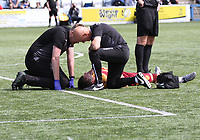 Christopher Long being treated for a head injury in the SPFL Betfred League Cup group match between Queen of the South and Motherwell at Palmerston Park, Dumfries on 13.7.19.