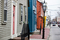 Storefronts line Thames Street in Newport, Rhode Island, seen here on Wed., April 19, 2017.
