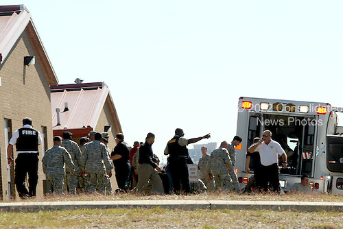 Fort Hood, TX - November 5, 2009 -- First responders prepare the wounded for transport in waiting ambulances near Fort Hood's Soldier Readiness Processing Center, Thursday, November 5, 2009. .Mandatory Credit: Jeramie Sivley - U.S. Army via CNP