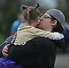 Elaina Borowski, 6, of Bethpage gets a hug and a kiss from her proud father, Jason Borowski, after she completed the 2016 Long Island Marathon Weekend's 1 mile race inside Mitchel Athletic Complex on Saturday, Apr. 30, 2016.