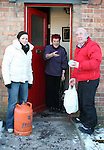 Barbara Tiernan and Michael Clarke from Drogheda Senior Citizens delivering groceries to Norma Thompson and her dog Badger who have been unable to leave the house due to the bad weather...Photo NEWSFILE/Jenny Matthews.(Photo credit should read Jenny Matthews/NEWSFILE)....This Picture has been sent you under the condtions enclosed by:.Newsfile Ltd..The Studio,.Millmount Abbey,.Drogheda,.Co Meath..Ireland..Tel: +353(0)41-9871240.Fax: +353(0)41-9871260.GSM: +353(0)86-2500958.email: pictures@newsfile.ie.www.newsfile.ie.FTP: 193.120.102.198.