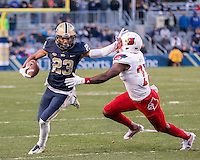 Pitt wide receiver Tyler Boyd (23) stiff-arms Lousiville Cardinal defensive back Jermaine Reve. The Pitt Panthers football team defeated the Louisville Cardinals 45-34 on Saturday, November 21, 2015 at Heinz Field, Pittsburgh, Pennsylvania.