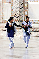 Agra, India.  Taj Mahal.  Two Young Indian Women Wearing Shalwar (Long Trousers) and Kameez (Long, Loose-fitting Shirt).