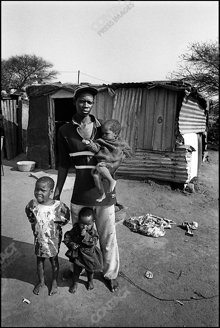 This man lives in this house with his 5 children. His wife has AIDS, Botswana, January 2000