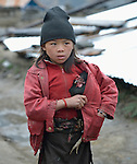 A girl carries a chicken through the village of Gatlang, in the Rasuwa District of Nepal near the country's border with Tibet.