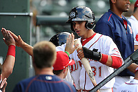 Shortstop Javier Guerra (31) of the Greenville Drive is congratulated after scoring a run in a game against the Savannah Sand Gnats on Sunday, July 5, 2015, at Fluor Field at the West End in Greenville, South Carolina. Guerra is the No. 13 prospect of the Boston Red Sox, according to Baseball America. Savannah won, 8-6. (Tom Priddy/Four Seam Images)