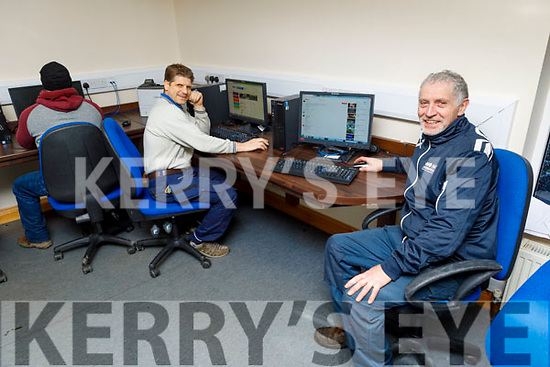 Michael Walsh and Dzmitry Arekhba on the computer in their computer room in the Shanakill Family Resource Centre